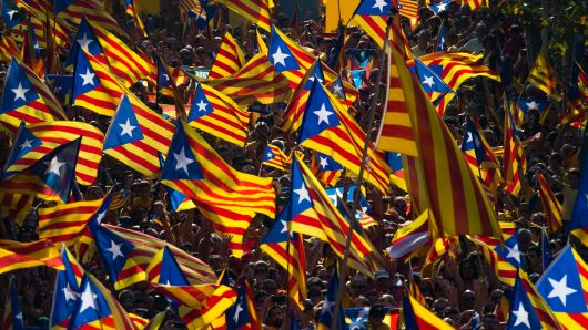 Demonstrators wave Pro-Independence Catalan flags during a demonstration as part of the celebrations of the National Day of Catalonia on September 11, 2014 in Barcelona, Spain.