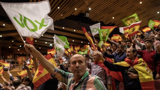 Supporters of far right wing party VOX wave Spanish and VOX flags as they attend a rally at Palacios de Congresos on April 17, 2019 in Granada, Spain.