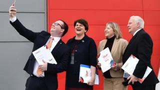 A DUP election candidate takes a selfie with party colleagues and leader Arlene Foster
