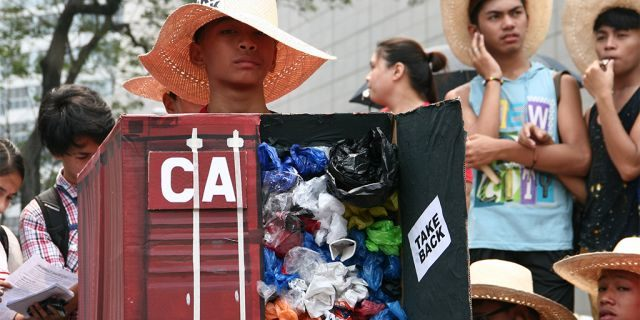 """Environmental activists protesting the tons of garbage Canada shipped to the Philippines in front of the Canadian Embassy in Makati in 2015.<br data-cke-eol=""""1"""">"""