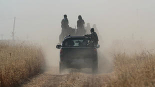 Turkey-backed Syrian rebel fighters near the Turkish-Syrian border, in Syria, October 12, 2019