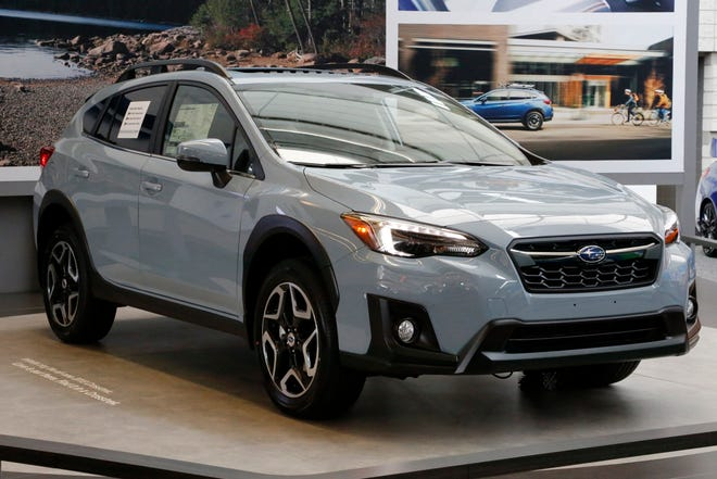Subaru is recalling over 400,000 vehicles in the U.S. to fix problems with engine computers and debris that can fall into motors. The first recall covers 466,000 Imprezas from 2017 through 2019, and 2018 and 2019 Crosstreks. (AP Photo/Gene J. Puskar, File)