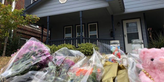 Bouquets of flowers and stuffed animals are piling up outside the Fort Worth home on Monday, where a 28-year-old black woman was shot and killed by a white police officer. (AP)