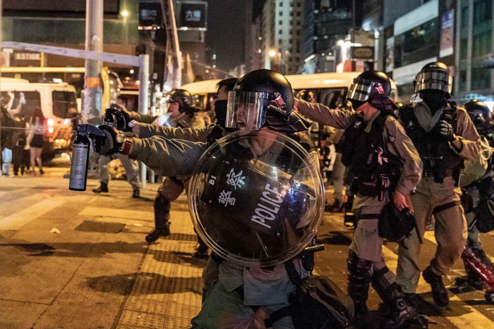PHOTO: Riot police uses pepper spray in Mongkok district against protesters, Oct. 13, 2019 in Hong Kong.